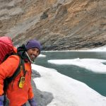 A narrow stretch of ice on the side on the Chadar Trek in Ladakh. Vishwas Raj founder of Adventure Sindbad poses