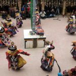 Monks dancing during the Spituk Gustor in Ladakh