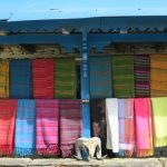 Colourful shawls for sale at a Tea-House on the Annapurna Base Camp Trek in Nepal