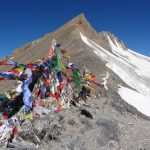 Parangla Pass with fluttering prayer flags on ParangLa Trek across Spiti and Ladakh by Adventure Sindbad