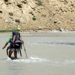 Crossing the river at Norbu Sumdo on ParangLa Trek across Spiti and Ladakh by Adventure Sindbad