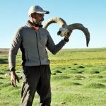 Vishwas Raj holding the Blue sheep skull at Chumik Shilte on ParangLa Trek across Spiti and Ladakh by Adventure Sindbad
