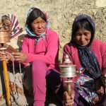 Locals spinning the prayer wheel at Demul on Spiti Village Walks trip by Adventure Sindbad