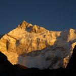 The first light illuminates Khangchendzonga on the Dzongri - Goechala Trek in Sikkim by Adventure Sindbad